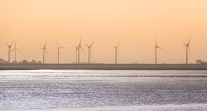 Windmills at the North Sea coast stock images