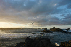 Windmills on an ocean coast. Royalty Free Stock Photos