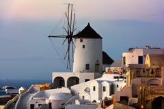 Windmills of Oia Village at Sunset, Santorini, Greece Stock Photo