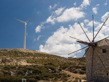 Windmills, old and new generation Royalty Free Stock Images