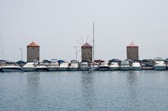 Windmills in old port of the ancient Town of Rhodes Royalty Free Stock Photos