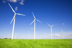 Windmills over green fields royalty free stock photo