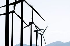 Windmills på soluppgången arkivfoto
