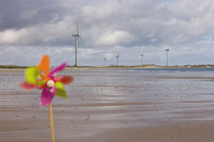 Windmills and pinwheel on shore Royalty Free Stock Image