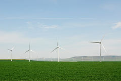 Windmills on plain Stock Photos