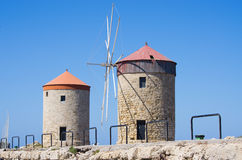 Windmills in the port of Rhodes, Greece Stock Photography