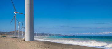 Windmills power generators at ocean coastline. Philippines Royalty Free Stock Photo