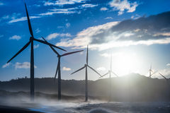 Windmills power generators at ocean coastline. Philippines Stock Photography