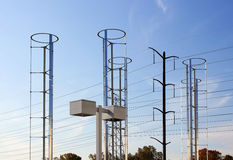 Windmills and Power Grid. Windmills on blue sky background royalty free stock image