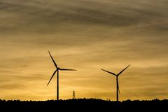 Windmills are producing electric for our world. royalty free stock photo