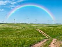 Windmills and rainbow Royalty Free Stock Photos