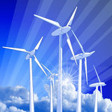 Windmills rays of light & blue sky Stock Images