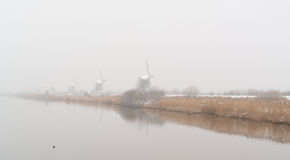 Windmills with reflection in the water Stock Photo