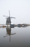 Windmills with reflection in the water Stock Images