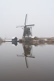 Windmills with reflection in the water Stock Image