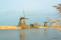 Windmills with reflection in the water Royalty Free Stock Photography