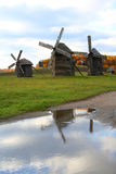 Windmills reflections. Over vivid autumn landscape Stock Image