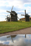 Windmills reflections. Over vivid autumn landscape Stock Images