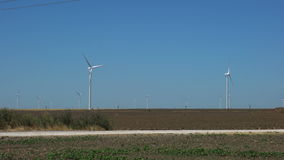Windmills for renewable electric energy production. Group of windmills for renewable electric energy production on a field stock footage