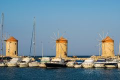 Windmills of Rhodes. Medieval windmills of Mandraki harbour, Rhodes town, Greece royalty free stock images