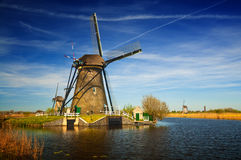 Windmills at riverside on a sunny day, Netherlands Stock Photography