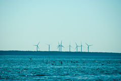 Windmills rotating in distance Royalty Free Stock Photos