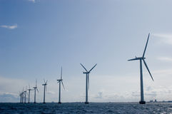 Windmills in a row with clear sky Stock Image