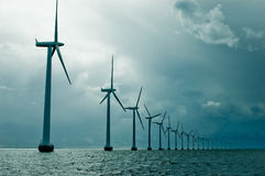 Windmills in a row on cloudy weather Royalty Free Stock Photography