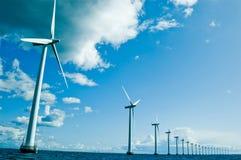 Windmills in a row horizontal, denamrk, baltic sea royalty free stock photography