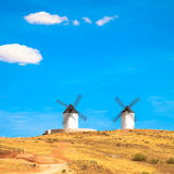 Windmills, rural green fields and blue sky. Consuegra, Spain Royalty Free Stock Photo
