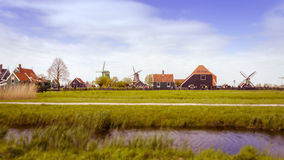 Windmills and rural houses in Zaanse Schans. Tilt-shift effect Royalty Free Stock Photography