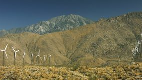 Windmills and San Jacinto. Motion control real time slider of windmills with Mount San Jacinto towering over them stock video footage