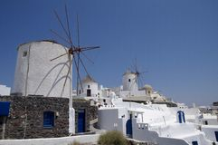 Windmills in Santorini Island Royalty Free Stock Photos