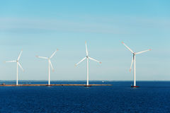 Windmills in the sea Royalty Free Stock Image