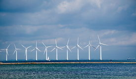 Windmills on the sea Stock Images