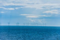 Windmills in the sea Stock Images