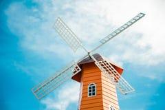 Windmills on sky background Stock Photo