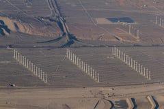 Windmills and smog Stock Photography