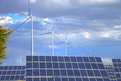 Windmills and solar panels royalty free stock photos