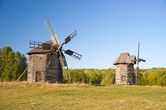 Windmills  standing on the edge of the autumn forest Royalty Free Stock Image