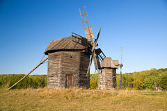 Windmills standing in the field against the blue sky Royalty Free Stock Photo