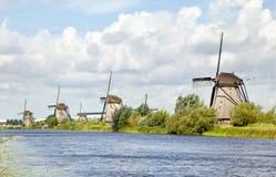 Windmills standing in a row, Kinderdijk Royalty Free Stock Photos