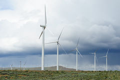 Windmills in storm Royalty Free Stock Photos