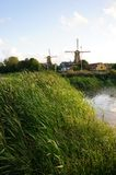 Windmills by a stream Stock Photo