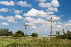 Windmills in summer landscape Stock Images