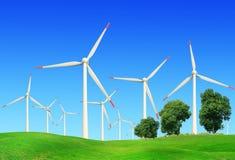 Windmills in summer landscape Stock Image