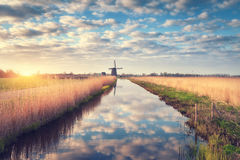 Windmills at sunrise. Rustic spring landscape Stock Photography