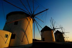 Windmills At Sunset. In Mykonos, Greece Royalty Free Stock Photo