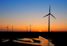 Windmills at sunset Royalty Free Stock Images