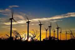 Windmills on sunset. A active stock of windmills on a sunset with blue and orang sky Royalty Free Stock Photo